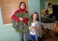 Jen and Sasha with their lovely creation - WNPJ's DIY wreath peace-tacular, Nov 29, 2013