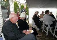 """Sen and Nancy Risser and host Mary Beth Schlagheck at WNPJ's """"Bring our war $$ home!"""" houseparty"""