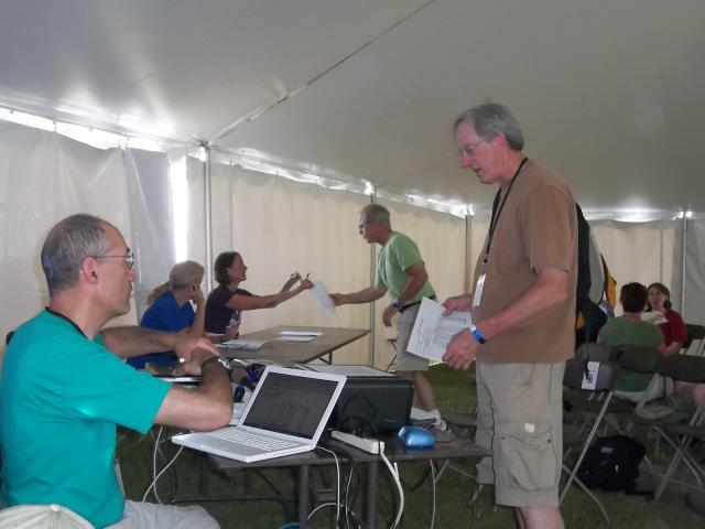 Workshop participants get info about their community's war spending, at the Energy Fair 2012